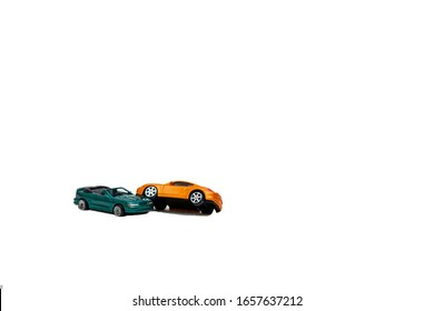 Close-up of a collision of two toy cars on a white background