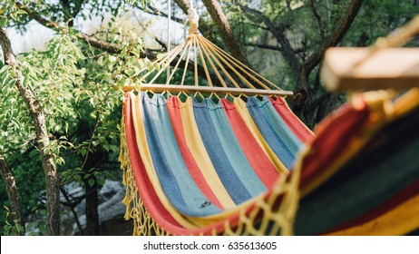 Close-up color travel hammock for relaxing in the trees. Stay in