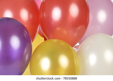 Close-up Colorful Balloons in full frame isolated on white