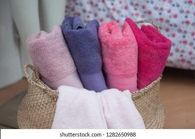 closeup of colorful bath towels in basket in store showroom