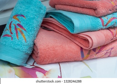 closeup of colorful bath towels pile on bed in decoration store showroom