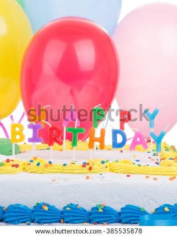 Closeup Of Colorful Birthday Cake With Balloons In Background