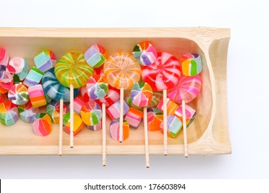 Close-up of colorful candy on white background, japanese traditional
