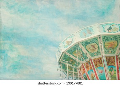 Closeup of a colorful carousel with blue sky background
