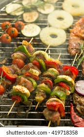 Close-up of colorful fresh shashliks frying on grill