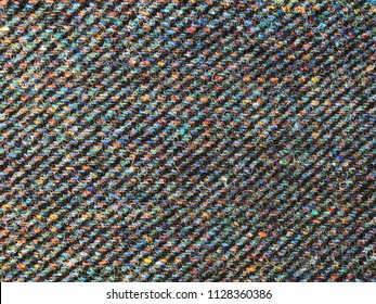 Closeup of colorful Harris tweed cloth, with line pattern.