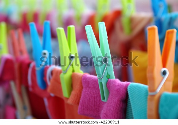 Close-up of colorful laundry pins and hanged clothes drying