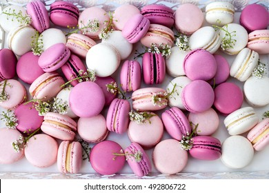 Closeup colorful macarons shades of pink. Natural light. Selective focus.