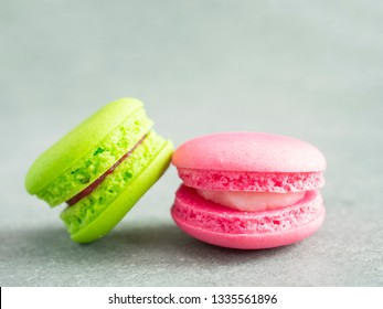 Closeup of colorful Macaroons with copy space on bare cement or concrete wall background