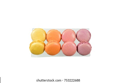 closeup of colorful macaroons or macaron french dessert in plate isolated on white background.