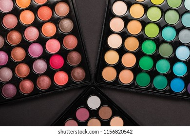 Close-up of colorful make-up palettes. Top view. Flat lay