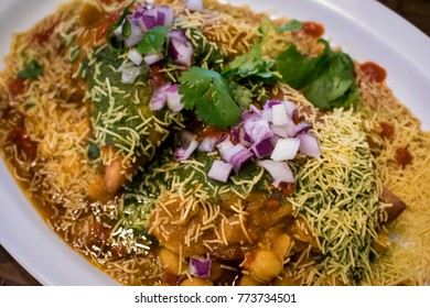 Closeup of a Colorful Samosa Chaat Indian Food Dish with Cilantro and Onions