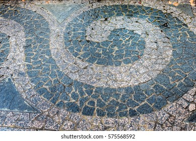 A closeup of a colorful sidewalk paver design at Grey Towers National Historic Site in Milford, Pennsylvania