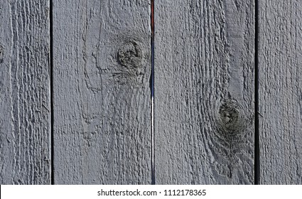 Closeup of a colorful wall photographed in the old town Porvoo, Finland. Beautiful vertical line and interesting texture. Close up photo which shows your every chip of the paint and crack of wood.