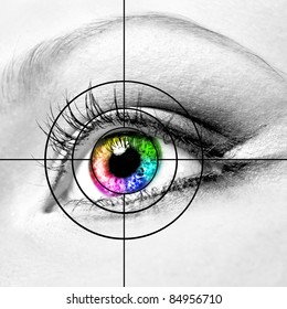 Close-up of colourful human eye and target