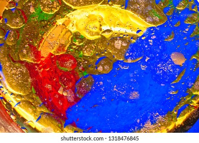 Close-up of Colourful Oil and Water Bubbles and Droplets.
