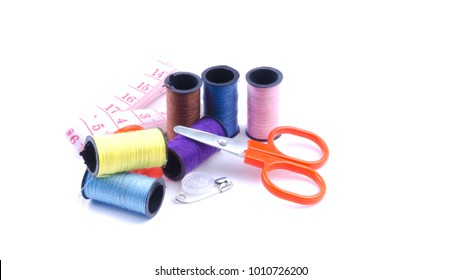 Closeup of colourful sewing tools on white background.Selective focus and crop fragment.