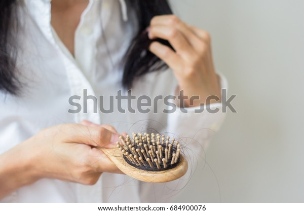 Closeup of comb brush with long loss hair with copy space-Healthcare concept.Selective focus.