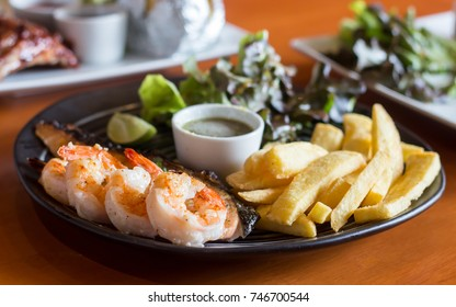 Close-up Combination Salmon Steak And Grilled Prawns isolated on Table.