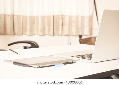 Close-up of comfortable working place with laptop, vintage effect style, selective focus