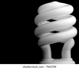 Close-up of a compact fluorescent light (CFL) bulb on black background