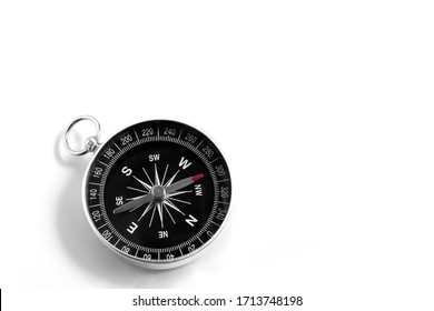 Closeup compass isolated on a white background. Travel geography navigation. Copy space