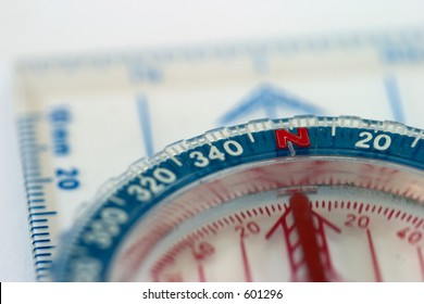 Close-up of a compass, shallow depth of field.