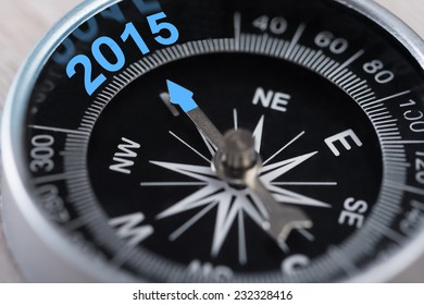 Closeup of compass showing new year 2015 direction