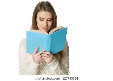 Closeup of concentrated woman reading the book, over white background