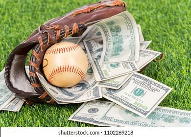 Closeup concept of baseball and money.