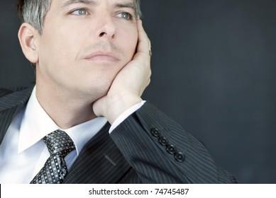 Close-up of a confident businessman gazing off camera.