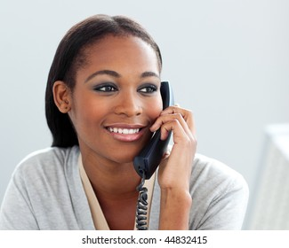 Close-up of a confident businesswoman on phone in the office