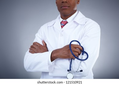 Close-up of confident doctor holding stethoscope