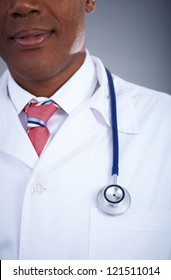Close-up of confident doctor in uniform with stethoscope