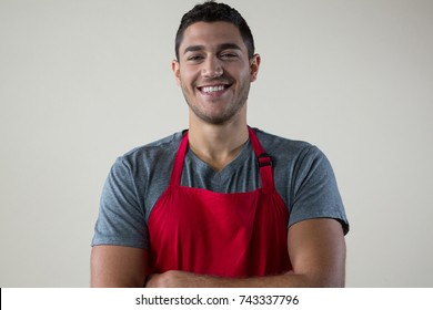 Close-up of confident waiter smiling at camera