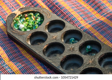 Close-up of a congkak or congklak which is a mancala marble game of Malay origin played in Malaysia, Philippines, Singapore, Indonesia, Brunei and Southern Thailand.