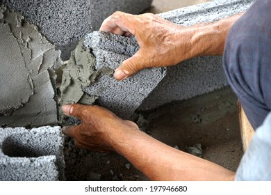 Close-up of construction process mason work with brick