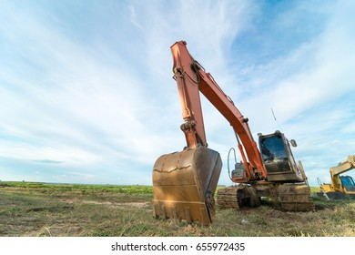 Close-up of a construction site excavator with blue sky