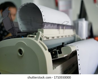 closeup of continuous paper printer in the office.