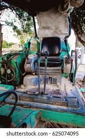 Closeup of control cranks with backhoe excavator, old