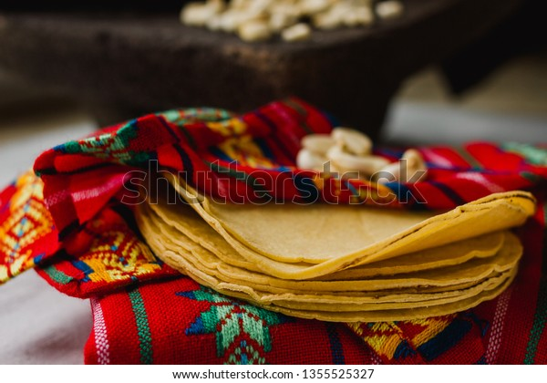 Close-up of corn tortillas on a mexican tortillero. Colorful Mexico food