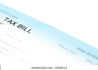 Closeup of the corner of a tax bill, isolated on white.