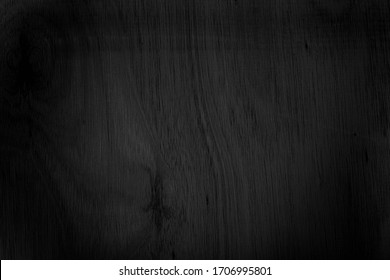 Close-up corner of wood grain Beautiful natural black abstract background Blank for design and require a black wood grain backdrop