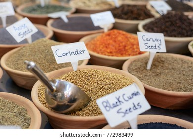 Closeup of a counter with a big  variety of spices on Jerusalem market in Israel.