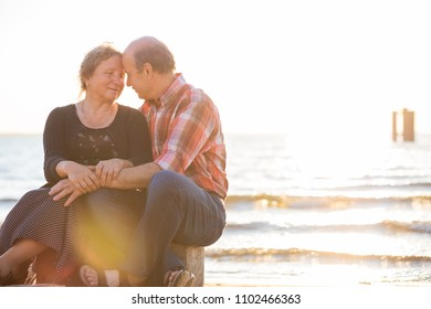Close-up of couple embracing outdoors. Concept of true love. Senior man and woman sitting together