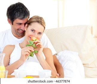 Close-up of couple having breakfast lying in the bed at home