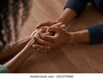 Close-up of couple holding each other's hand