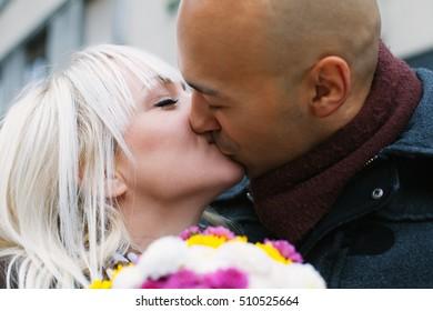 Closeup of a couple kissing