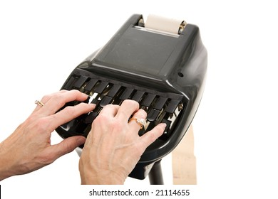 Closeup of a court reporters hands typing on a stenography machine.  Isolated on white background.