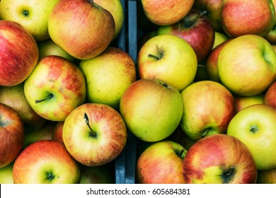 Closeup of crates of juicy, fresh, ecologically produced apples, Fuji, without nitrates in the market for fruit and vegetables. Concept health, agriculturally.